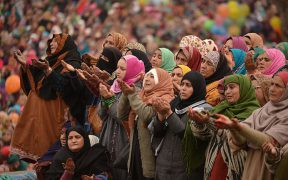 Kashmiri Muslims pray as a custodian displays a relic believed to be a hair from the beard of Prophet Mohammed on the last Friday of celebrations marking Eid-e-Milad-un-Nabi, the birthday of the prophet, at the Hazratbal Shrine in Srinagar on December 16, 2016. Thousands of Kashmiri Muslims gathered at the shrine in the summer capital of Jammu and Kashmir to offer prayers on the Prophet's birth anniversary. / AFP / TAUSEEF MUSTAFA (Photo credit should read TAUSEEF MUSTAFA/AFP/Getty Images)
